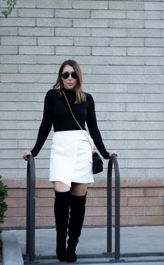 How to Style A Black Turtleneck. Black turtleneck sweater+white skirt+black over the knee boots+black chain crossbody bag+aviator sunglasses. Fall Outfit 2016
