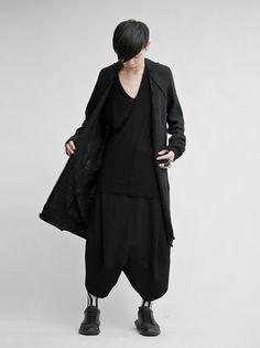 Black layered knitwear with harem pants by Japanese designer MA_JULIUS