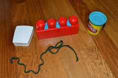Lego (teeth), Playdough (food particles), Yarn (dental floss)