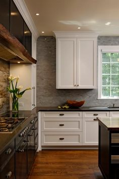 HGTV.com shares a stunning contemporary, rustic kitchen with custom details.