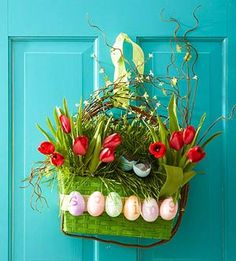 Welcome spring with this adorable door display, from the cover of Midwest Living! More spring door decor: http://www.midwestliving.com/homes/seasonal-decorating/spring/wreaths/