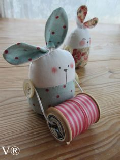 Bunny holding thread pincushion