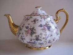 Royal Albert 1940s English Chintz pattern teapot ... pink roses and blue forget-me-nots floral decoration with gilded handle, spout, rim, foot and knob, from 100 Years of Royal Albert Centenary Collection commemorative series (reproduced one pattern for each decade 1900s-1990s), c. 2006, bone china, UK