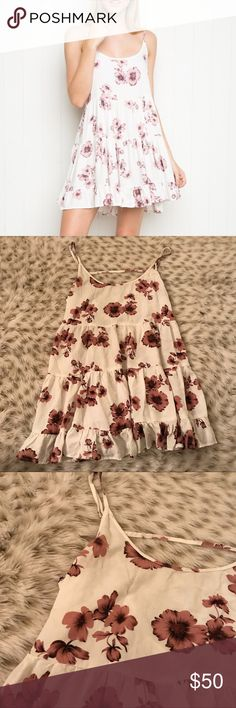 Rare Brandy Melville Jada Floral Tank Dress Rare brandy Melville Floral tank Jada dress! Tank dress with open back and ruffle layers! One size fits all! Best fits size XS-s. Length is about 28 inches from shoulder to hem. Super cute and in excellent condition! Color is like first pic! It looks darker in my pictures because it was taken at night ! Brandy Melville Dresses Mini