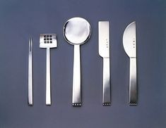 Josef Hoffman (1870 – 1956), five pieces from the 'Flat Model' flatware service, consisting of crab fork, sardine server, pastry serving spoon, cheese knife, and butter knife. 1904 – 1908, Silver. Execution: Wiener Werkstatte.