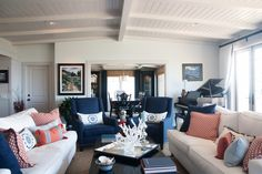 Two sofas, navy chairs