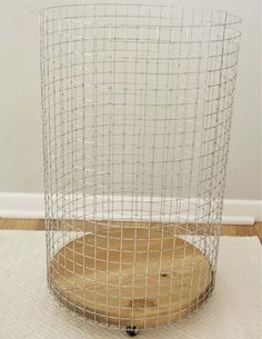 "Cheap & Chic: How To Make a French-Vintage-Inspired Wire Hamper Make a rolling wire laundry basket with a wood round and some hardware cloth. Add a cute canvas liner and you have a chic ""vintage"" hamper!"