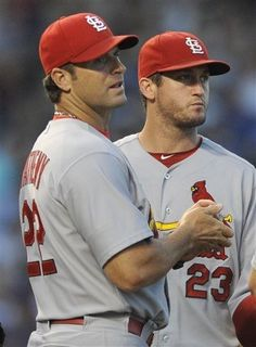 manager Mike Matheny and third baseman David Freese look on after starting pitcher Lance Lynn was pulled during the fifth inning of a game against the Chicago Cubs.  Cards lost 6-4.  7-13-13