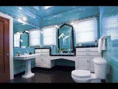 Fully tiled original art deco bathroom in blue with black tile detailing