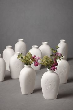 ceramic BHLDN vases with numbers printed on the sides // View more: http://ruffledblog.com/community/recycle-your-wedding-browse/reception/bhldn-inscribed-numeral-vases-11235.html