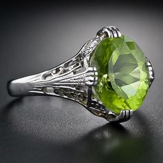 Peridot Ring - I need a ring like this. I can't seem to find large pieces of peridot that aren't on necklaces.