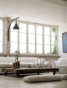 huge window. low coffee table. pillow as seating.