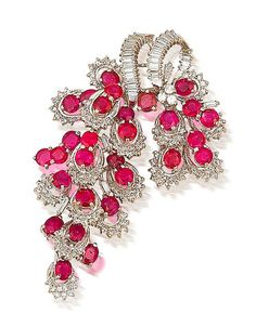 A ruby and diamond brooch - Formed as a highly articulated stylised bunch of grapes, set throughout with mixed-cut rubies, baguette and single-cut diamonds, mounted in 18k white gold, the rubies estimated to weigh approximately 11.60 carats in total, the diamonds estimated to weigh approximately 4.30 carats in total, length 7cm Z