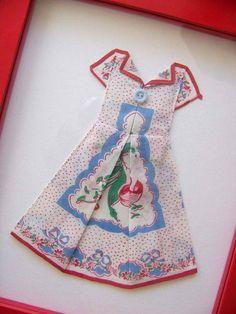 Folding a handkerchief to make a dress.