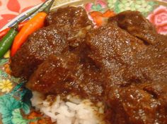 Rendang Padang - Indonesian Beef Curry (Slow Cooker) This is a very close representation to what I have had in restaurants. But beware because it can be quite spicy depending on the heat of the chiles you use. The beef should be almost falling apart. Serve with steamed white rice and Achar. From Secrets of Slow Cooking.