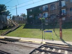The Darby station on SEPTA's Wilmington-newark Regional Rail commuter train line on 4th Street near Colwyn Avenue in Darby, Pennsylvania. This is the first stop on the line outside of the Philadelphia city limits. The Millicent Courts Apartment building can be seen in the background.