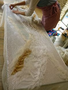 Student and bride-to-be laying out fibres for her wedding shawl