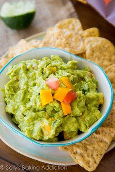 Simple Mango Guacamole: Ingredients: 3 ripe avocados, 1 mango, peeled and diced, 1 small tomato, diced, half of a jalapeño pepper, diced*, juice from 1 lime, salt, to taste Optional: 1/4 cup diced onion and chopped cilantro, to taste Directions: visit sallysbakingaddiction.com