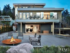 LUXE Interiors + Design | This three-story Northwest modern house with a cubic stacking, recalls the De Stijl movement of the 1920s.