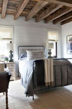Look at that rustic wood ceiling. Those wood posts are beautiful. This bedroom collection is dreamy. It would make me want to stay in bed all day because of how stunning these master bedrooms are. Love all of them. #masterbedroom #farmhousemasterbedroom #neutralbedroom #whitebedroom #cozybedroom #cozymasterbedroom #rusticmasterbedroom #woodbeams #shiplapwall #shiplap #woodandwhitehome