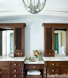 On a wall in the master bath of a Lake Michigan house designed by Martin Horner, tumbled Blue Celeste tile by Ann Sacks sparkles in the light. The walnut cabinetry looks like furniture, not built-ins.   - HouseBeautiful.com