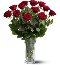 """TF31-1  For classic romance, a dozen red roses is always the perfect choice.    One dozen long-stemmed red roses in a clear glass vase.    Approximately 20"""" W x 24"""" H    Orientation: All-Around"""