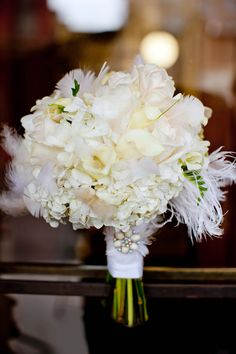 1930's art deco inspired bouquet with white cream flowers with feathers. Habitat floral and photo by Yous Photography.