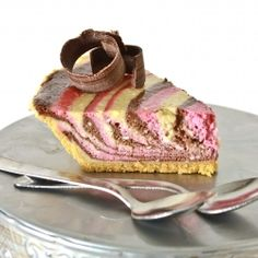 Neapolitan Zebra Cheesecake . . . Easily the most impressive dessert you'll ever make. Believe it or not, this delicious recipe isn't hard to pull off!