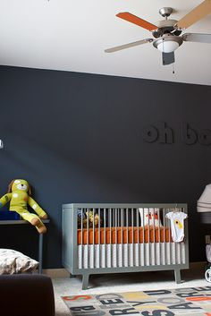 Nursery by suzz, via Flickr. The grey color is Olympic Paint D58-5 Knights Armor in eggshell. The paint is good, zero VOC and low odor...but it takes thicker coat to achieve even coverage.