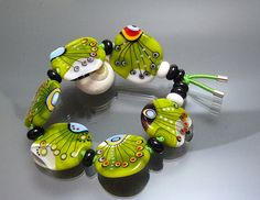 Melanie Moertel Lampwork Beads - Elastic bracelet with 6 handmade glass beads in green and black. $150.00, via Etsy.