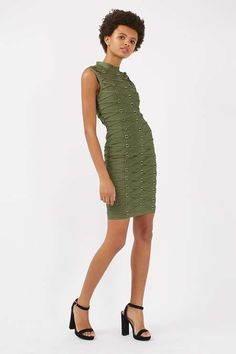 Show off your silhouette in this tape bandage bodycon dress in a luxe khaki finish. In a flattering midi cut, it comes with a high neckline. Accessorise with a classic clutch and killer heels to keep the look sleek