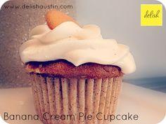 Banana Cream Pie Cupcake - banana cake with a banana cream pudding center, topped with fresh whipped cream