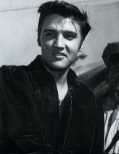 Homecoming Concert at the Tupelo Fairgrounds in Mississippi on Wednesday, September 26, 1956 - afternoon show | Elvis is wearing his dark blue velvet shirt that Natalie Wood's dress designer made for him together with an identical red one. See more: http://www.scottymoore.net/tupelo.html