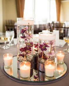 Floating flowers and candle centerpiece Candle Centerpieces, Candles, Floating Flowers, Purple Wedding, Plymouth, Wedding Ideas, Club, Weddings, Table Decorations
