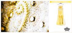 Bridal Gown: Distinctive gold detail