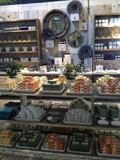Store display. Love the contrast between the plain white trays and rustic wood.