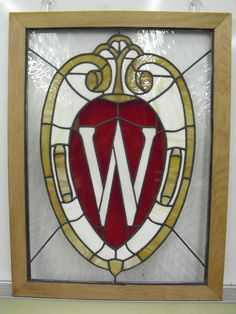 My Cousin makes the coolest stained glass!!! - University of Wisconsin Academic Logo Stained Glass