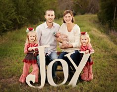Font: Custom. Custom used the letters JOY to add some fun props to her 2011 Christmas card.The photographer is Sarah Giles of Butterfly Chaser Photography