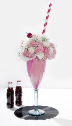 Grease flower centerpiece #sweetsixteen #graduation #partyideas #graduationparty #partythemes #1950sparty #sodashop #sockhop #rockabilly #partydecor #partydecorations 50s Party Decorations, Anniversary Party Decorations, Party Centerpieces, Anniversary Parties, Flower Centerpieces, Graduation Party Themes, 50th Party, Happy Days Theme, Grease Themed Parties