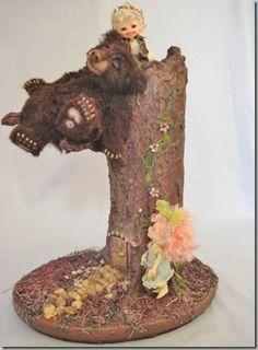 Teddy bear asleep in a fairy tree