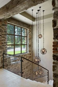 A homestead in Montana blends rustic and modern details is part of Staircase lighting ideas - This stunning homestead was designed by Locati Architects in collaboration with interior design studio Joszi Meskan Associates, located in Bozeman, Montana Staircase Lighting Ideas, Stairway Lighting, Foyer Lighting, Lighting Design, Chandelier Staircase, Modern Staircase, Rustic Contemporary, Modern Rustic, Rustic Elegance