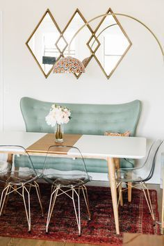 teal loveseat in a mod dining room