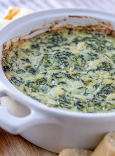 Cheesy spinach and artichoke dip is a favorite restaurant appetizer you can make at home easily in 30 minutes! Creamy, cheesy, and loaded with flavor, it's sure to be a crowd pleaser. Spinach Artichoke Dip, Spinach Dip, Yummy Appetizers, Appetizers For Party, Appetizer Recipes, Party Dips, Dinner Parties, Tapas, Recipes