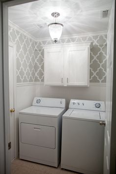 Grey stenciled laundry room with wallpaper wainscoting. The after photo of my laundry room thanks to pinterest.