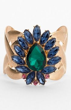 This sparkly emerald and sapphire crystal cuff is breathtaking.