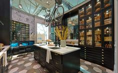 A bike hangs over the kitchen island in Style at Home's IKEA kitchen, next to a bread-filled pantry.