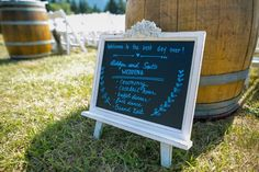 chalkboard wedding welcome sign with schedule in shabby chic frame