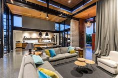 Double Height Living Spaces Add Drama to This Industrial-Style House