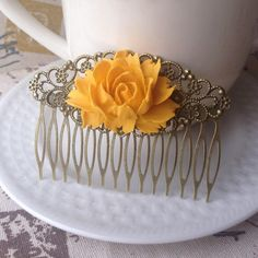 """Mustard Yellow Rose Hair Comb This hair comb can be worn for many occasions including weddings,dances,parties,a fancy night on the town or even a casual day out. Comb is brass filigree. Adorned with a gorgeous mustard yellow blooming rose. Measures 3 1/2 X 2 1/4"""". Perfect for spring & summer! Handmade & brand new. Bundle & save 15% on 3+ items Tags: Shabby chic,vintage,bridal,pin up,romantic. Abbie's Anchor Accessories Hair Accessories"""