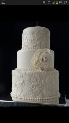 """Lace wedding cake with pearls and flower"" This is the cutest cake I think I have ever seen <3"
